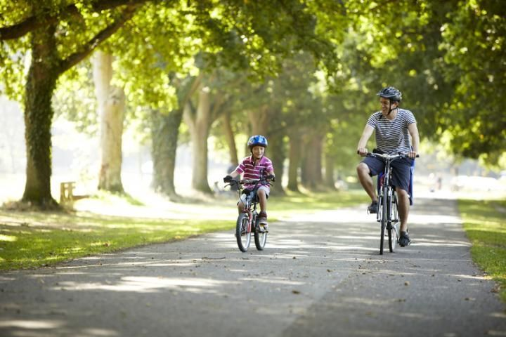 Father and son cycling at Southampton Common