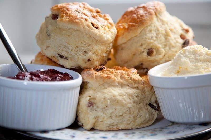 close up of scones, jam and cream