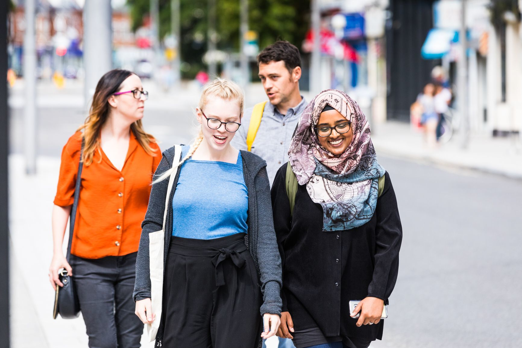Group of friends walking down a street