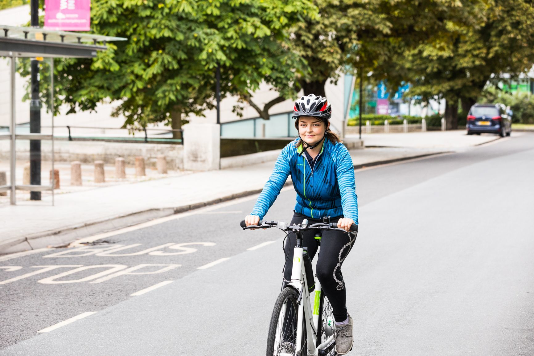 woman cycling on a road
