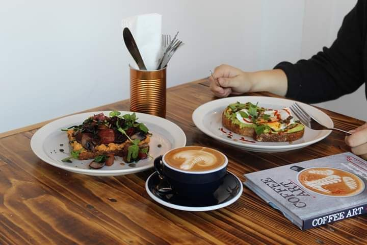 food and coffee on a table in Coffee Lab