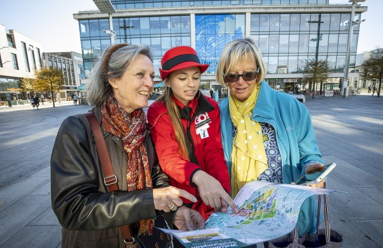 Women looking at map