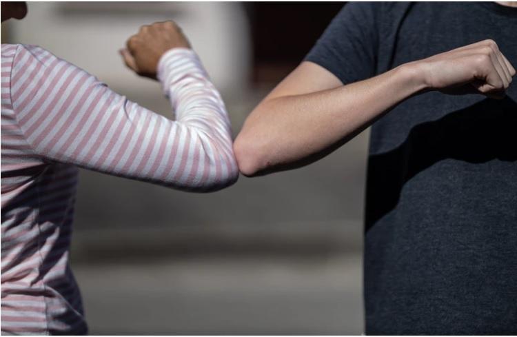 Elbow greeting Unsplash